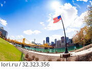 Купить «US national flag in Roberto Clemente Memorial Park», фото № 32323356, снято 26 апреля 2018 г. (c) Сергей Новиков / Фотобанк Лори