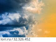 Купить «Драматические синие грозовые тучи и золотистые облака, освещенные лучами солнца. Небесный пейзаж, символизирующий смену погоды, времени года, сезона», фото № 32326452, снято 1 сентября 2019 г. (c) А. А. Пирагис / Фотобанк Лори