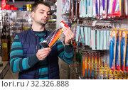 buyer choosing fishing lures. Стоковое фото, фотограф Яков Филимонов / Фотобанк Лори