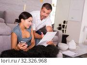 Купить «Happy couple reading letter», фото № 32326968, снято 17 июля 2018 г. (c) Яков Филимонов / Фотобанк Лори