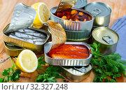 Купить «Open cans with canned seafood», фото № 32327248, снято 13 ноября 2019 г. (c) Яков Филимонов / Фотобанк Лори