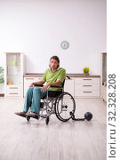 Купить «Young male invalid in wheel-chair suffering at home», фото № 32328208, снято 23 июля 2019 г. (c) Elnur / Фотобанк Лори
