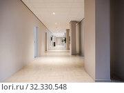 Купить «Long office hallway modern design, empty and clean interior white walls.», фото № 32330548, снято 1 ноября 2018 г. (c) age Fotostock / Фотобанк Лори