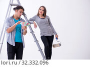 Купить «Young family doing renovation at home», фото № 32332096, снято 4 марта 2019 г. (c) Elnur / Фотобанк Лори