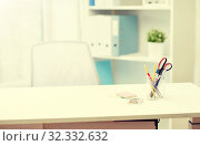 stationery on table in office interior. Стоковое фото, фотограф Syda Productions / Фотобанк Лори