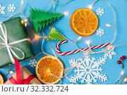 Купить «christmas gifts and decorations», фото № 32332724, снято 26 сентября 2018 г. (c) Syda Productions / Фотобанк Лори