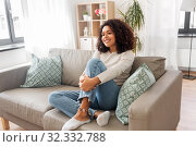 Купить «happy african american young woman at home», фото № 32332788, снято 22 сентября 2019 г. (c) Syda Productions / Фотобанк Лори