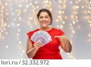 Купить «happy woman showing euro money banknotes», фото № 32332972, снято 15 сентября 2019 г. (c) Syda Productions / Фотобанк Лори