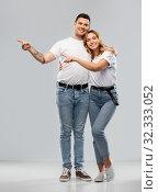 Купить «happy couple in white t-shirts pointing fingers», фото № 32333052, снято 6 октября 2019 г. (c) Syda Productions / Фотобанк Лори
