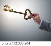 Купить «Businessman holding key in real estate concept», фото № 32333204, снято 6 декабря 2019 г. (c) Elnur / Фотобанк Лори