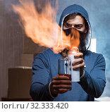 Купить «Rebel with molotov cocktail in dark room», фото № 32333420, снято 11 августа 2017 г. (c) Elnur / Фотобанк Лори