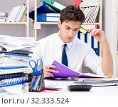 Купить «Businessman working in the office with piles of books and papers», фото № 32333524, снято 3 августа 2017 г. (c) Elnur / Фотобанк Лори