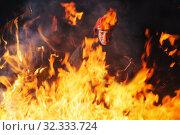 Купить «firefighter puts out a fire at night», фото № 32333724, снято 23 октября 2019 г. (c) Майя Крученкова / Фотобанк Лори