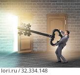 Купить «Businessman with key and jigsaw puzzle pieces», фото № 32334148, снято 4 декабря 2019 г. (c) Elnur / Фотобанк Лори