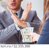 Купить «Businessmanbeing offered bribe for breaking law», фото № 32335388, снято 11 декабря 2017 г. (c) Elnur / Фотобанк Лори
