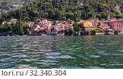 Купить «Picturesque view of small city of Varenna on shore of Lake Como on background of mountain on summer day, Italy», видеоролик № 32340304, снято 18 ноября 2019 г. (c) Яков Филимонов / Фотобанк Лори