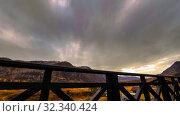 Купить «Timelapse of wooden fence on high terrace at mountain landscape with clouds. Horizontal slider movement», видеоролик № 32340424, снято 17 марта 2018 г. (c) Александр Маркин / Фотобанк Лори