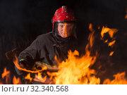 Купить «firefighter puts out a fire at night», фото № 32340568, снято 23 октября 2019 г. (c) Майя Крученкова / Фотобанк Лори