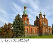 Купить «Tampere Red Orthodox Church was built in 1896-1899. It is also known as St. Alexander Nevski and St. Nicolas Church. Finland», фото № 32342024, снято 20 сентября 2019 г. (c) Валерия Попова / Фотобанк Лори