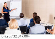 Купить «Young woman sharing business ideas with colleagues», фото № 32347004, снято 31 мая 2020 г. (c) Яков Филимонов / Фотобанк Лори