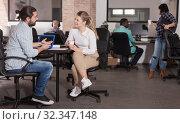 Купить «Male and female entrepreneurs discussing project», фото № 32347148, снято 16 марта 2019 г. (c) Яков Филимонов / Фотобанк Лори