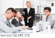 Businesswoman feeling angry to coworkers. Стоковое фото, фотограф Яков Филимонов / Фотобанк Лори