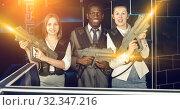 Smiling associates – afro man and two European women posing at. Стоковое фото, фотограф Яков Филимонов / Фотобанк Лори