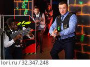 Купить «men and women co-workers having corporate entertainment», фото № 32347248, снято 4 апреля 2019 г. (c) Яков Филимонов / Фотобанк Лори