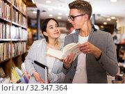 Купить «man and girl are looking for information in books», фото № 32347364, снято 18 января 2018 г. (c) Яков Филимонов / Фотобанк Лори