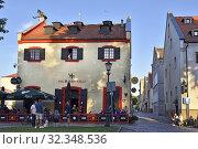 Купить «The Portobello pub, Old Harbour district, Klaipeda, port city on the Baltic Sea, Lithuania, Europe.», фото № 32348536, снято 23 июня 2019 г. (c) age Fotostock / Фотобанк Лори
