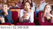 Number of people enjoying film screening and popcorn. Стоковое фото, фотограф Яков Филимонов / Фотобанк Лори