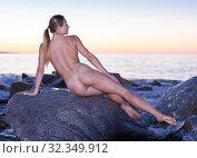 Young nude female is lying on a rock. Стоковое фото, фотограф Яков Филимонов / Фотобанк Лори