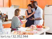 Купить «Woman introducing boyfriend to mother», фото № 32352944, снято 17 августа 2019 г. (c) Яков Филимонов / Фотобанк Лори