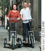 Купить «Mature couple staying with electric bikes», фото № 32353040, снято 14 июля 2020 г. (c) Яков Филимонов / Фотобанк Лори