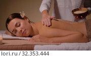 Купить «beautiful young woman having salt massage at spa», видеоролик № 32353444, снято 19 октября 2019 г. (c) Syda Productions / Фотобанк Лори