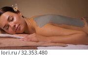 Купить «woman with blue clay mask on her back at spa», видеоролик № 32353480, снято 19 октября 2019 г. (c) Syda Productions / Фотобанк Лори