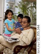 Купить «Kids spending time with their grandfather», фото № 32355344, снято 17 января 2008 г. (c) easy Fotostock / Фотобанк Лори