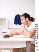 Купить «Young male student preparing for exams at home», фото № 32355656, снято 31 августа 2019 г. (c) Elnur / Фотобанк Лори