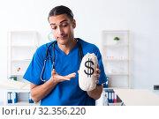 Купить «Young male doctor working in the clinic», фото № 32356220, снято 25 июня 2019 г. (c) Elnur / Фотобанк Лори