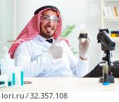 Купить «Arab chemist working in the lab office», фото № 32357108, снято 21 апреля 2018 г. (c) Elnur / Фотобанк Лори