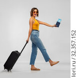 Купить «happy young woman with air ticket and travel bag», фото № 32357152, снято 30 сентября 2019 г. (c) Syda Productions / Фотобанк Лори