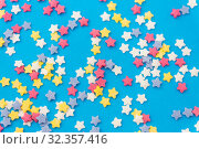 Купить «star shaped pastry sprinkles on blue background», фото № 32357416, снято 11 декабря 2018 г. (c) Syda Productions / Фотобанк Лори