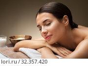 Купить «young woman lying at spa or massage parlor», фото № 32357420, снято 13 октября 2019 г. (c) Syda Productions / Фотобанк Лори
