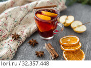 Купить «glass of hot mulled wine with orange and cinnamon», фото № 32357448, снято 4 октября 2018 г. (c) Syda Productions / Фотобанк Лори