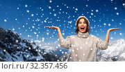 Купить «young woman in knitted winter hat in mountains», фото № 32357456, снято 30 сентября 2019 г. (c) Syda Productions / Фотобанк Лори