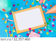 Купить «white board, birthday gift and party props», фото № 32357460, снято 11 декабря 2018 г. (c) Syda Productions / Фотобанк Лори