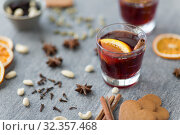 Купить «hot mulled wine, orange slices, raisins and spices», фото № 32357468, снято 4 октября 2018 г. (c) Syda Productions / Фотобанк Лори