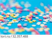 Купить «star shaped pastry sprinkles on blue background», фото № 32357488, снято 11 декабря 2018 г. (c) Syda Productions / Фотобанк Лори