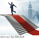 Купить «The young businessman climbing stairs and red carpet», фото № 32358024, снято 29 февраля 2020 г. (c) Elnur / Фотобанк Лори