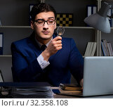 Купить «The auditor looking for errors in financial reporting for compan», фото № 32358108, снято 21 декабря 2017 г. (c) Elnur / Фотобанк Лори